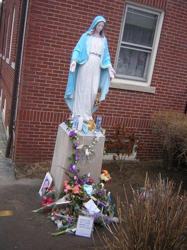 Do cathlics worship the virgin mary